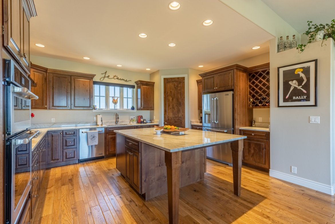 Kitchen with Island - 2927 Sleeping Bear Rd Montrose, CO 81401 - Atha Team Real Estate
