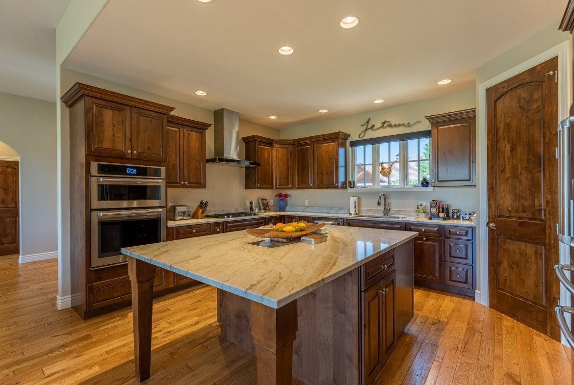 Kitchen with Island Seating Area - 2927 Sleeping Bear Rd Montrose, CO 81401 - Atha Team Real Estate