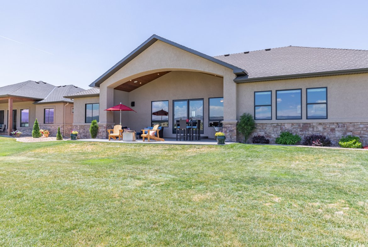 Covered Back Patio and Lawn - 2927 Sleeping Bear Rd Montrose, CO 81401 - Atha Team Real Estate