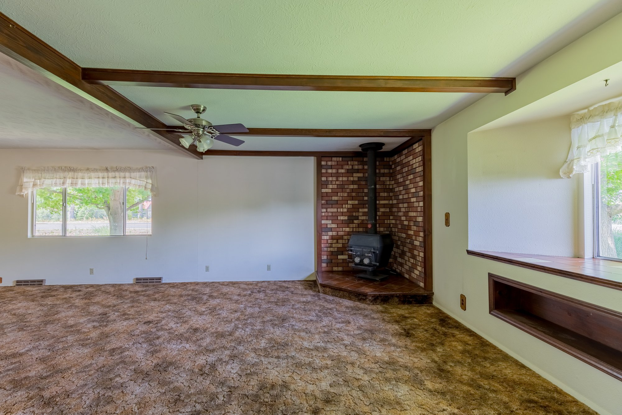 Living Room with Wood Burning Stove - 418 6400 Rd Montrose, CO 81403 - Atha Team Realty