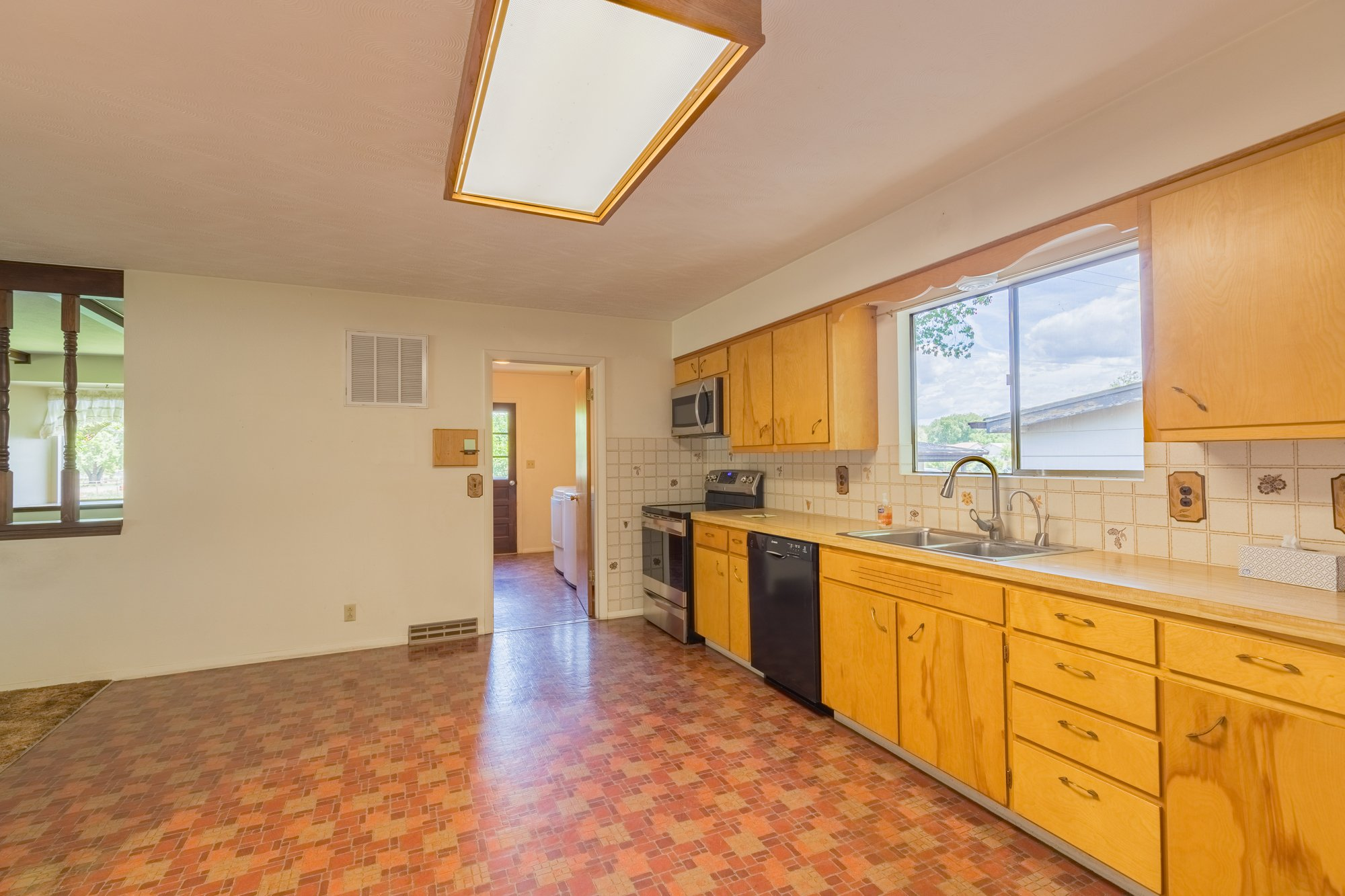 Kitchen to Laundry Room - 418 6400 Rd Montrose, CO 81403 - Atha Team Realty