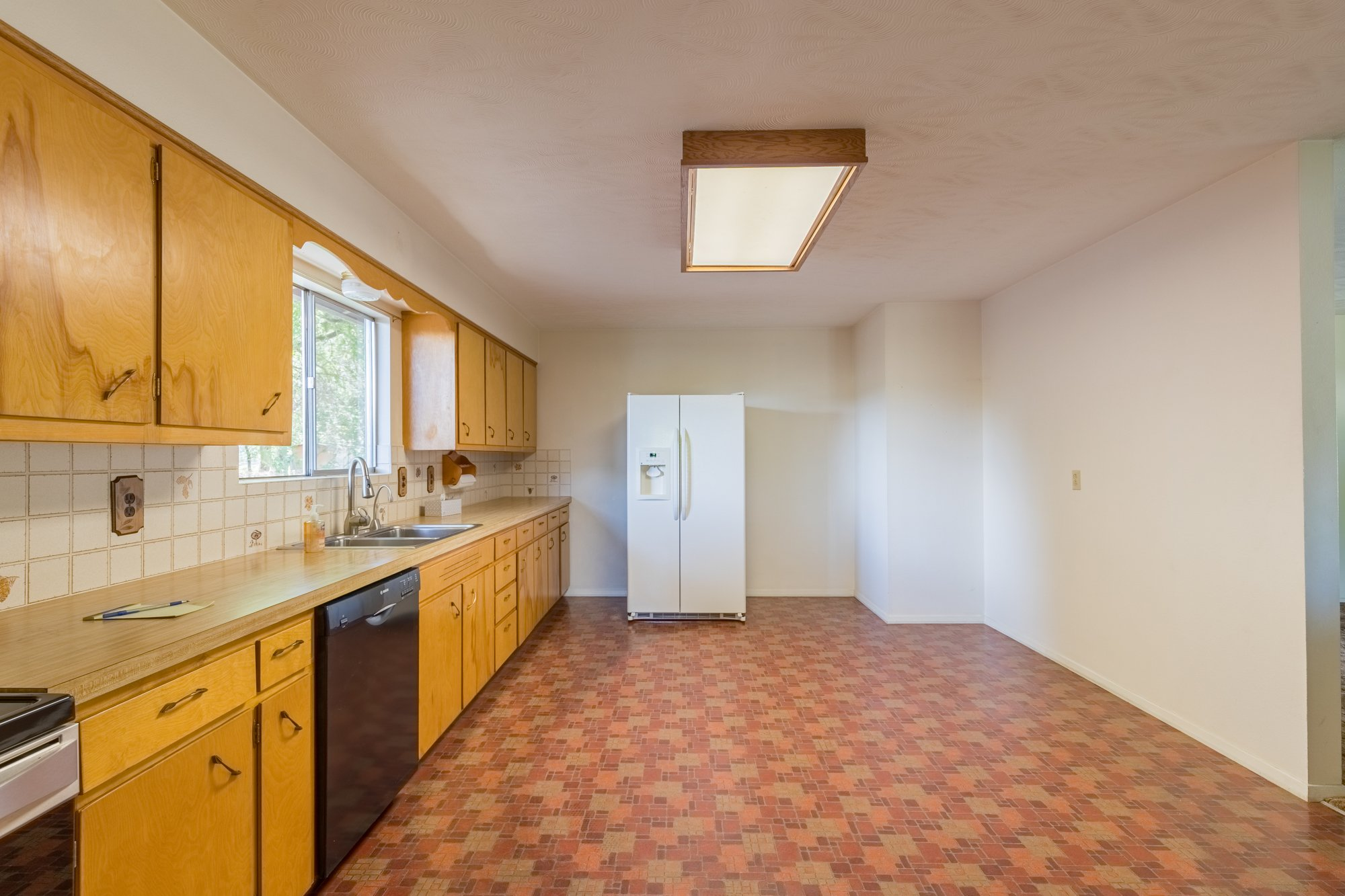 Kitchen with Refrigerator - 418 6400 Rd Montrose, CO 81403 - Atha Team Realty
