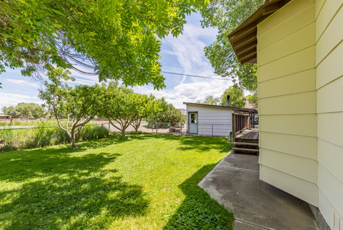 Back of Home with Covered Entry- 418 6400 Rd Montrose, CO 81403 - Atha Team Realty
