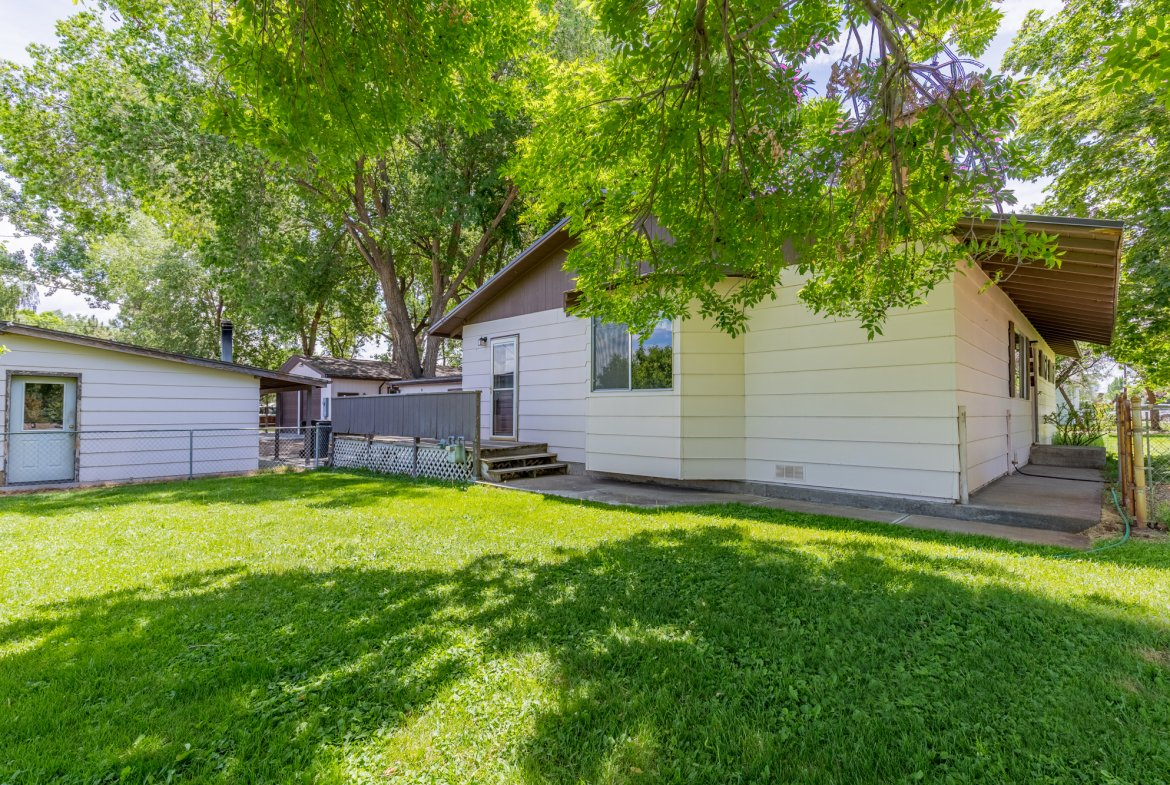 Back of Home with Lawn - 418 6400 Rd Montrose, CO 81403 - Atha Team Realty