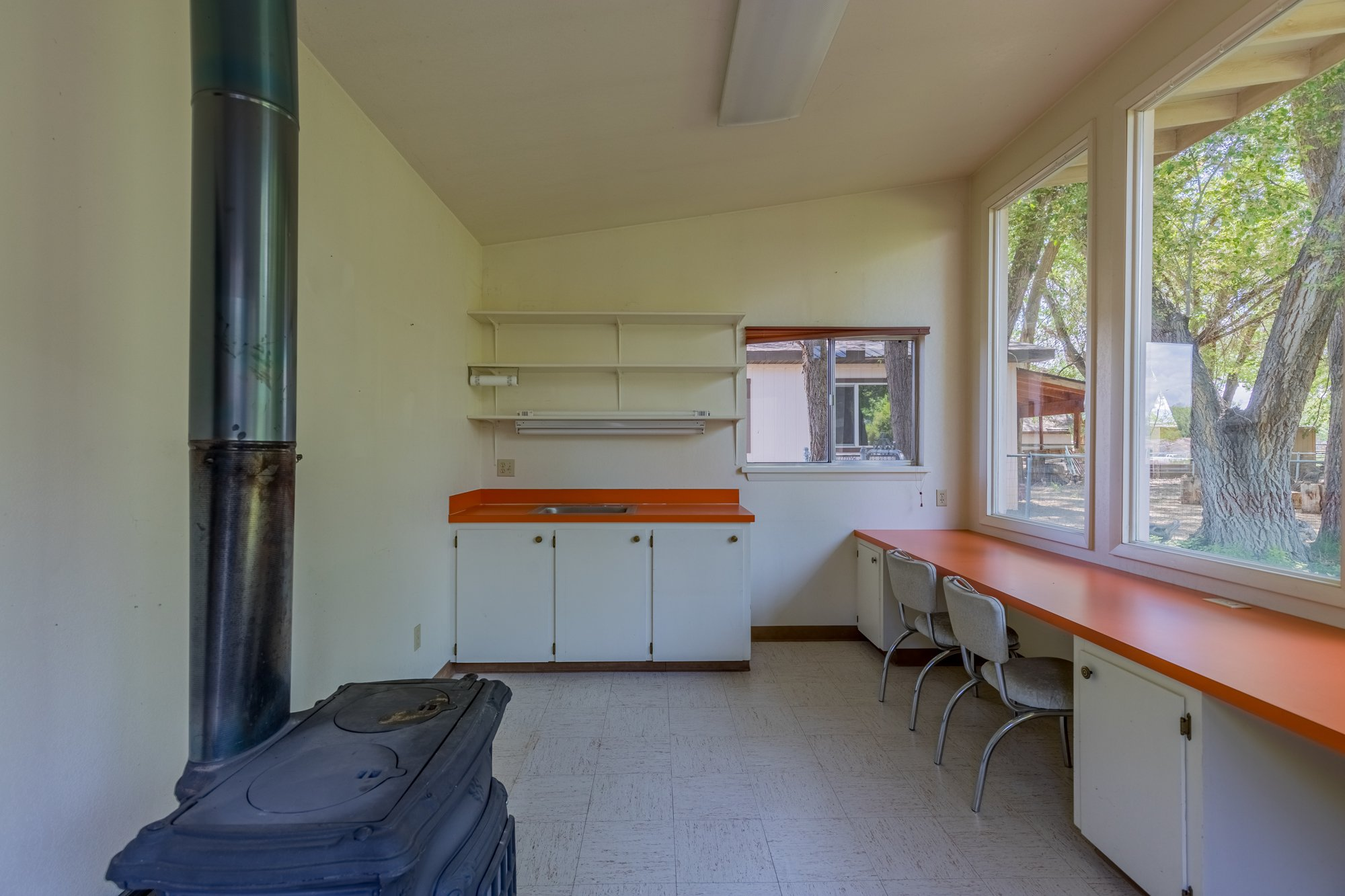 Shed with Wood Stove - 418 6400 Rd Montrose, CO 81403 - Atha Team Realty