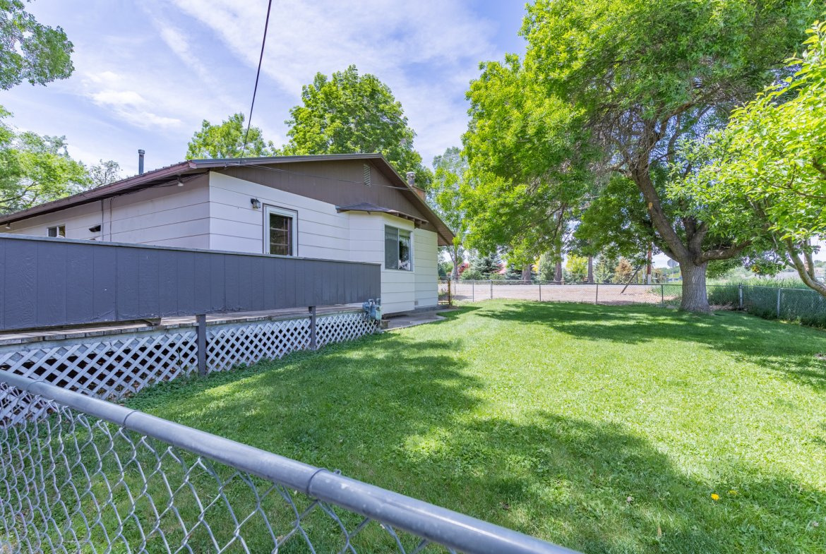 Fenced Yard - 418 6400 Rd Montrose, CO 81403 - Atha Team Realty