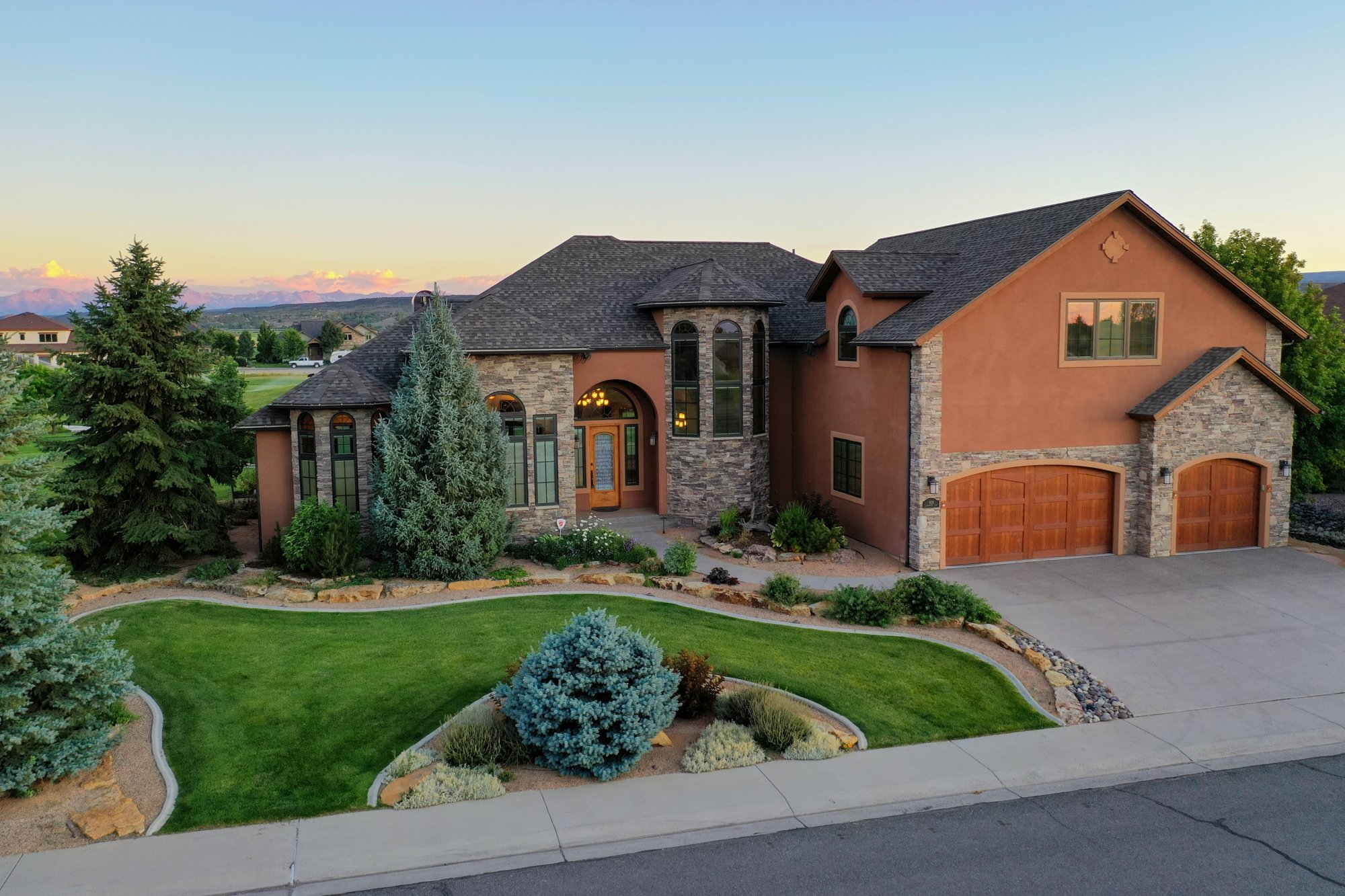 Aerial View Front of Home with Landscaping - 924 Courthouse Peak Lane Montrose, CO 81403 - Atha Team Golf Luxury Real Estate