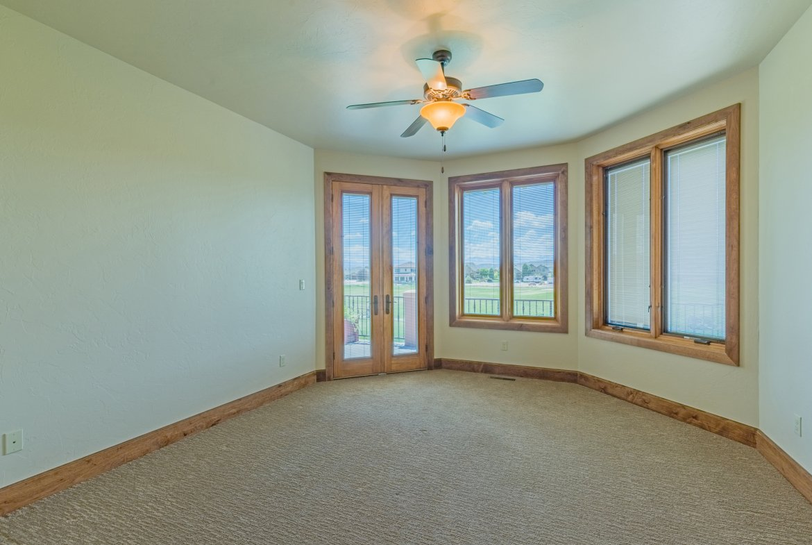 Guest Bedroom with Balcony Access - 924 Courthouse Peak Lane Montrose, CO 81403 - Atha Team Golf Luxury Real Estate