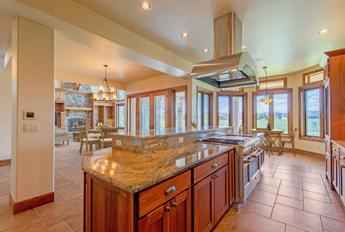 Kitchen with Island and Vent Hood - 924 Courthouse Peak Lane Montrose, CO 81403 - Atha Team Golf Luxury Real Estate