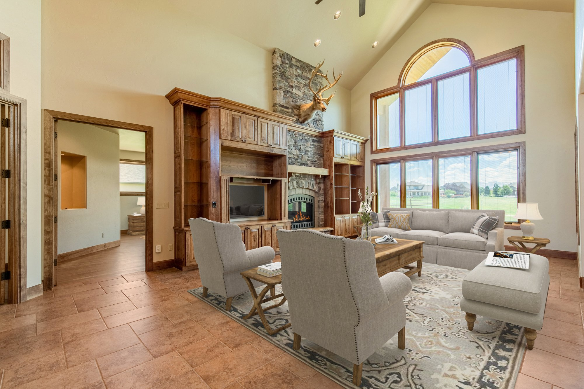 Living Room with Fireplace - 924 Courthouse Peak Lane Montrose, CO 81403 - Atha Team Golf Luxury Real Estate
