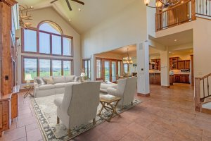 Living Room with Ceiling Fan - 924 Courthouse Peak Lane Montrose, CO 81403 - Atha Team Golf Luxury Real Estate