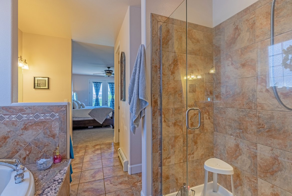 Main Bathroom with Tiled Shower - 2924 Lost Creek Rd S. Montrose, CO 81401 - Atha Team Real Estate Agents