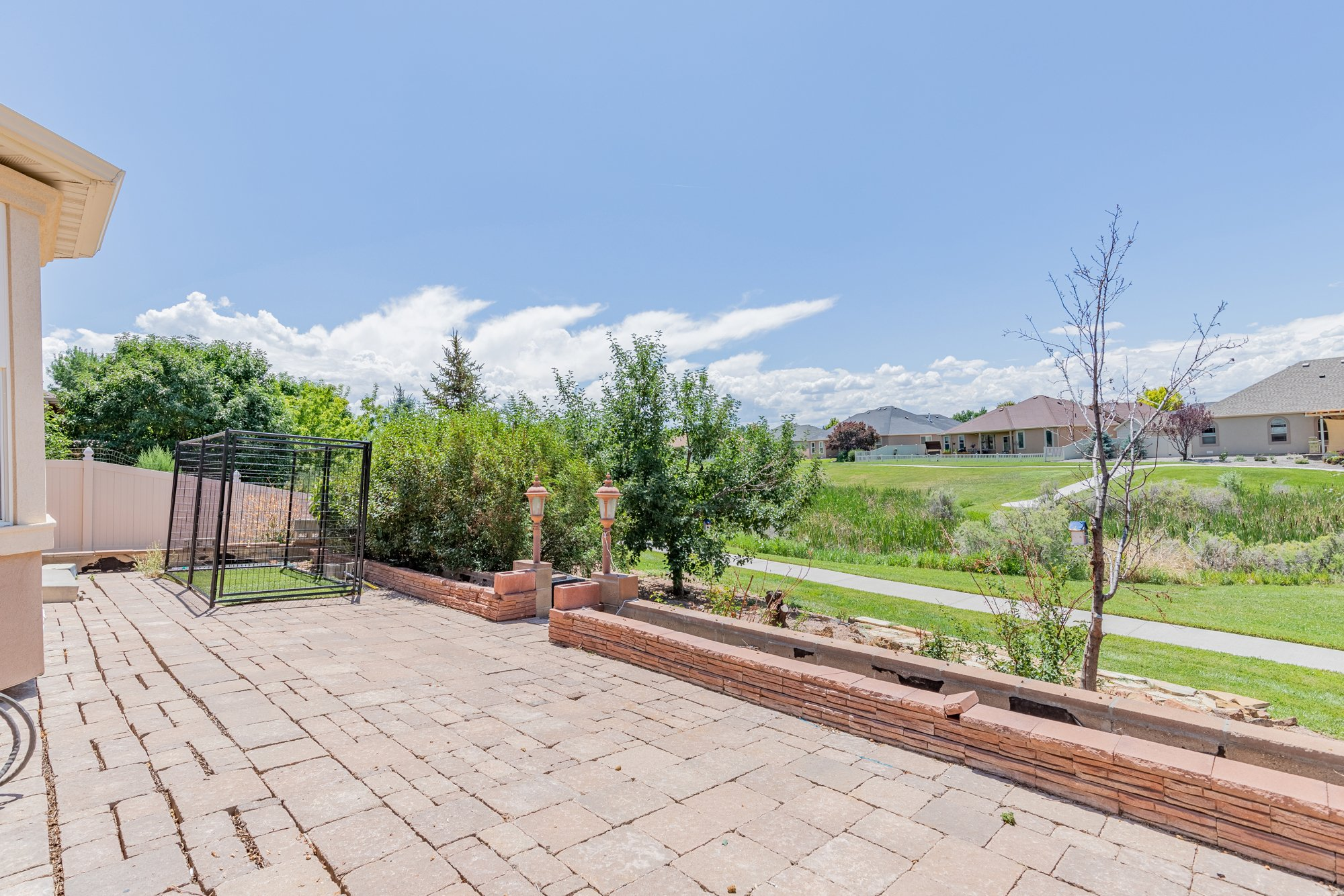 Back Patio with Pond Views - 2924 Lost Creek Rd S. Montrose, CO 81401 - Atha Team Real Estate Agents