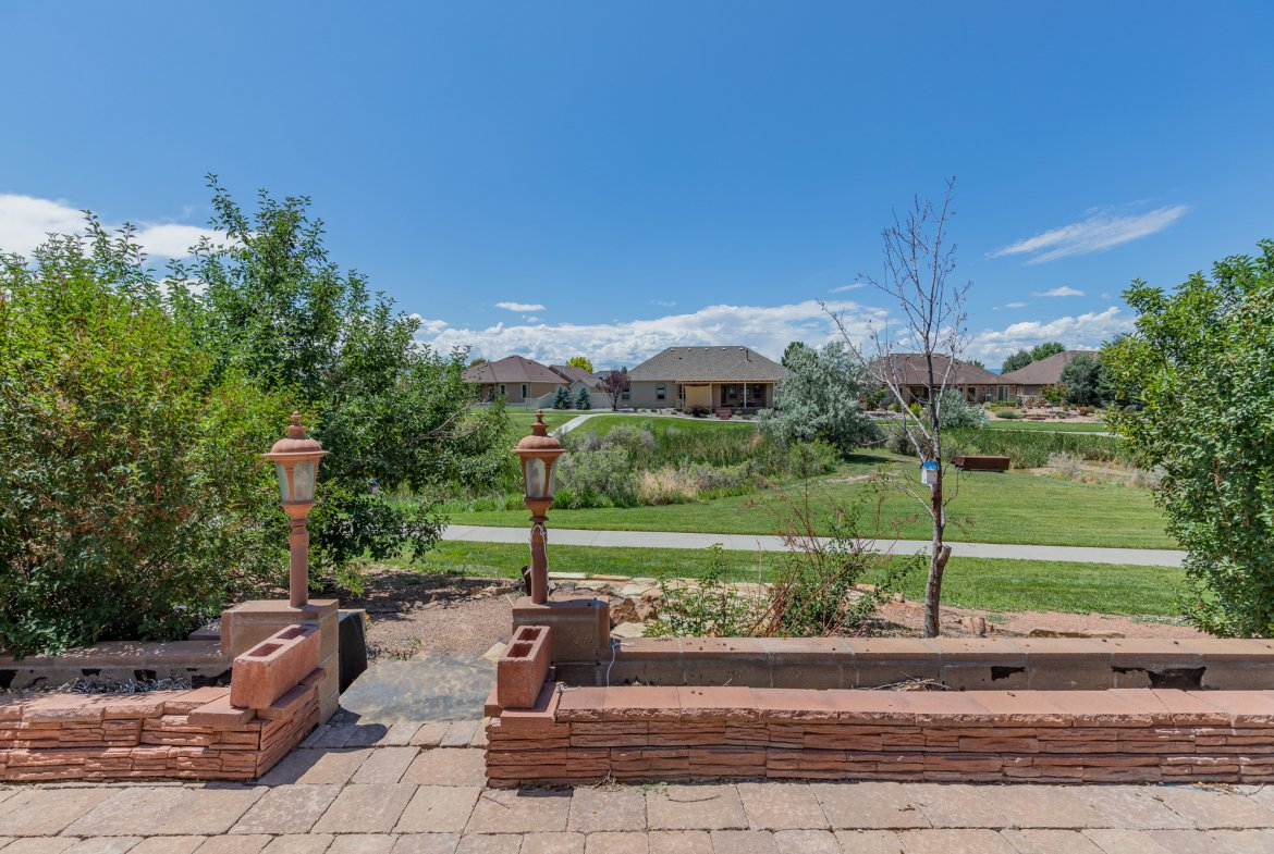 Back Patio with Landscaping - 2924 Lost Creek Rd S. Montrose, CO 81401 - Atha Team Real Estate Agents