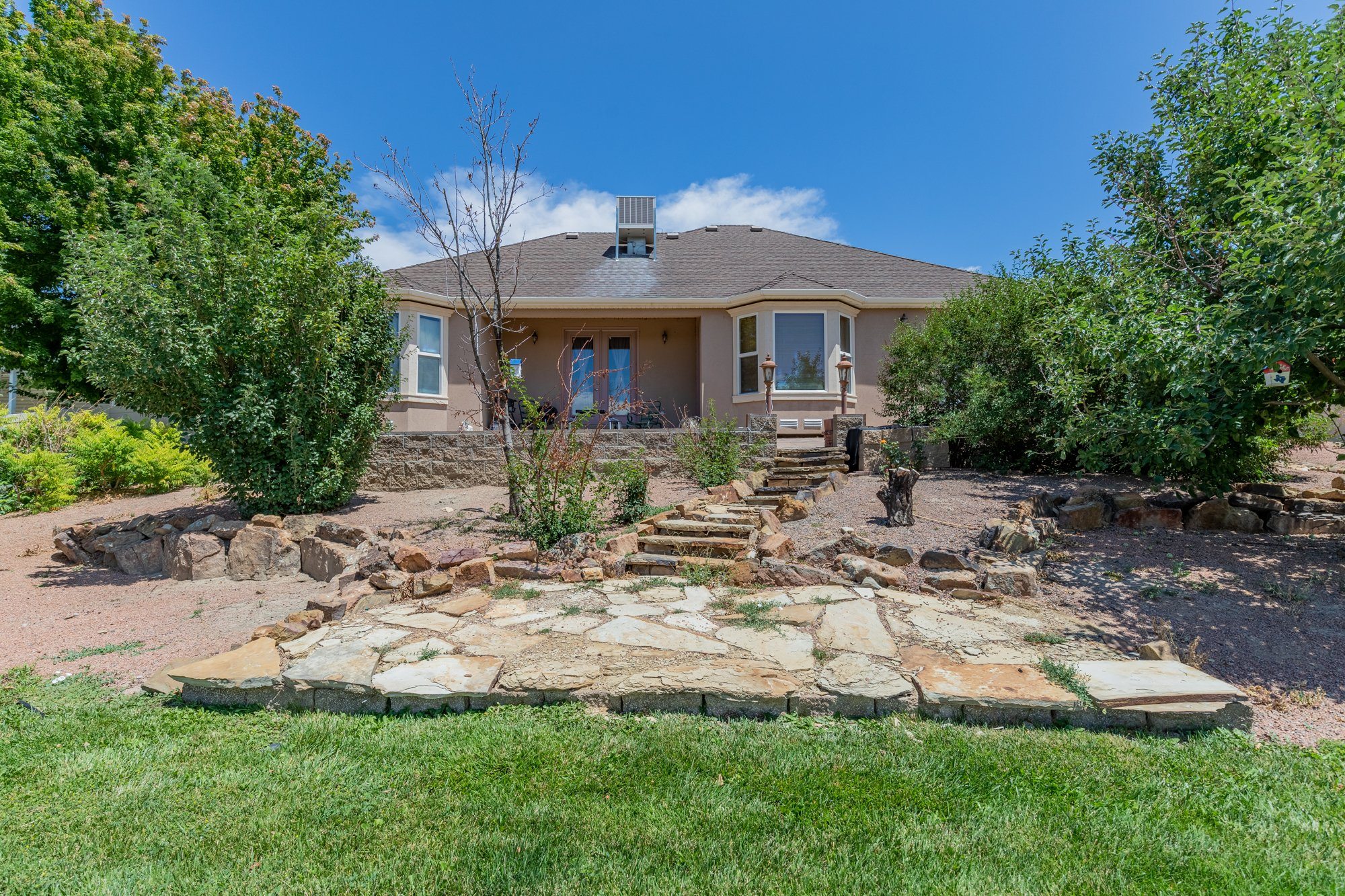 Back Yard with Landscaping - 2924 Lost Creek Rd S. Montrose, CO 81401 - Atha Team Real Estate Agents