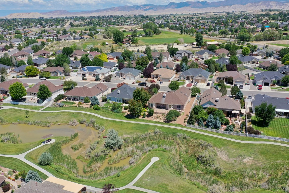 Aerial View with Pond Views - 2924 Lost Creek Rd S. Montrose, CO 81401 - Atha Team Real Estate Agents