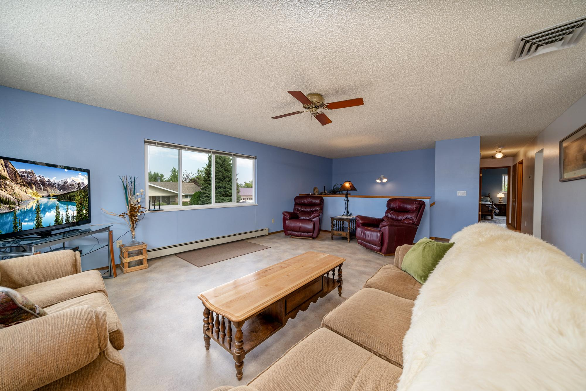 Living Room with Ceiling Fan - 1311 Manchester Dr Montrose, CO 81401 - Atha Team Realty Agents
