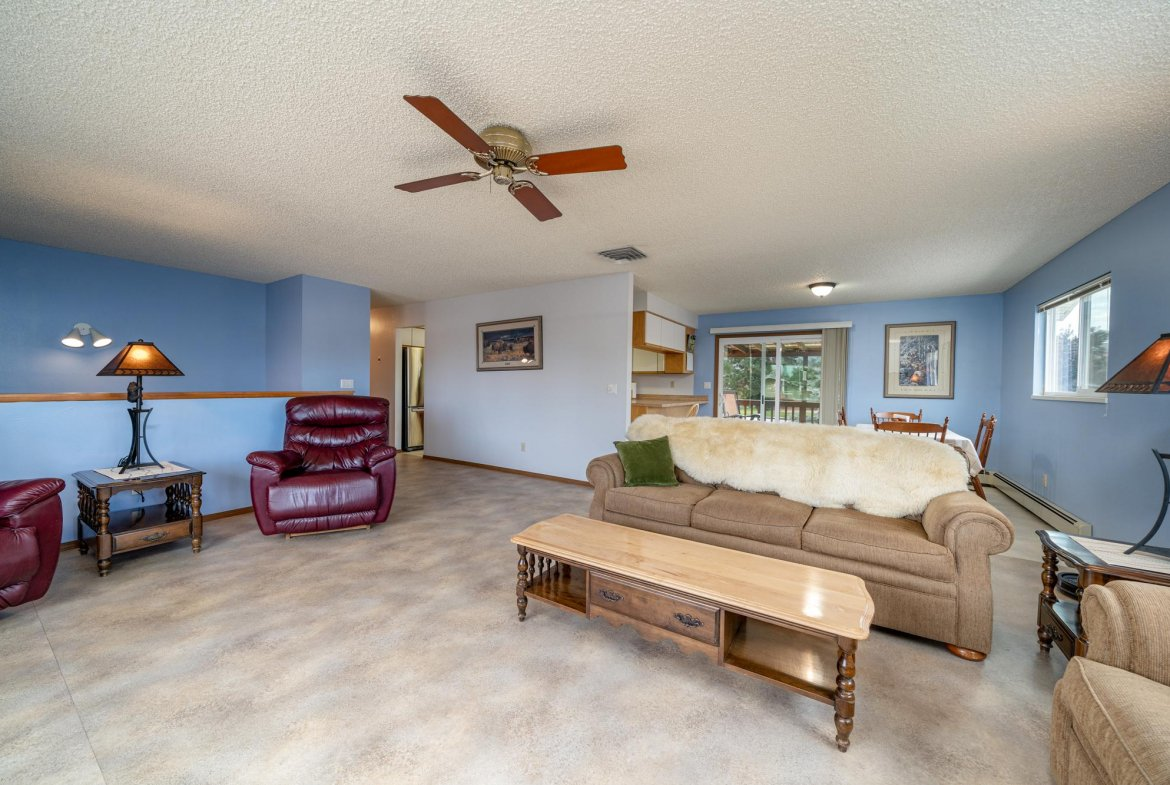 Living Room with Stairs Down - 1311 Manchester Dr Montrose, CO 81401 - Atha Team Realty Agents