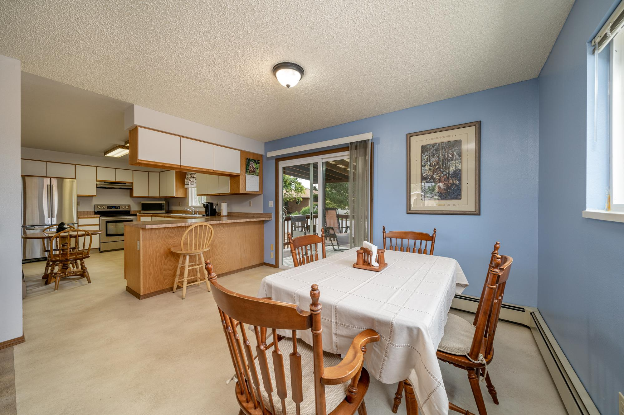 Dining Room with Sliding Glass Doors - 1311 Manchester Dr Montrose, CO 81401 - Atha Team Realty Agents