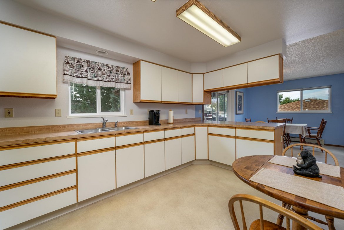 Kitchen with Ample Cabinet Space - 1311 Manchester Dr Montrose, CO 81401 - Atha Team Realty Agents