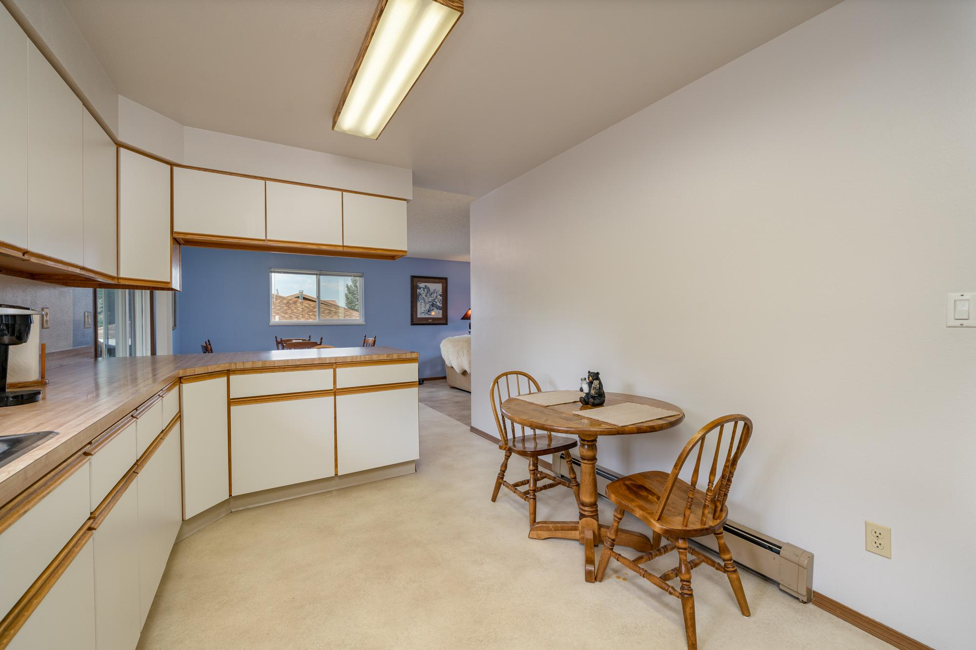Kitchen with Breakfast Nook - 1311 Manchester Dr Montrose, CO 81401 - Atha Team Realty Agents