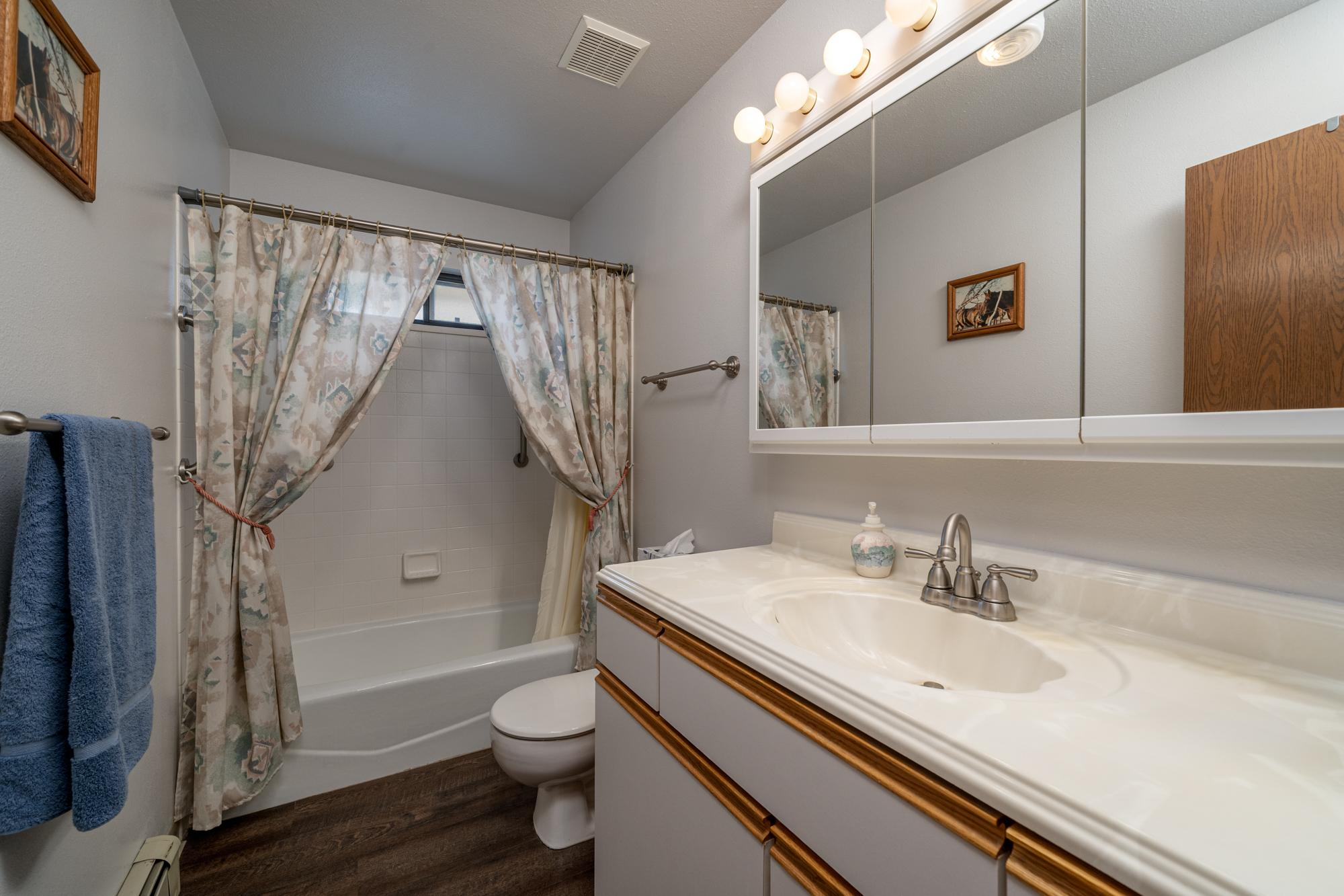 Bathroom with Vinyl Wood Floor - 1311 Manchester Dr Montrose, CO 81401 - Atha Team Realty Agents