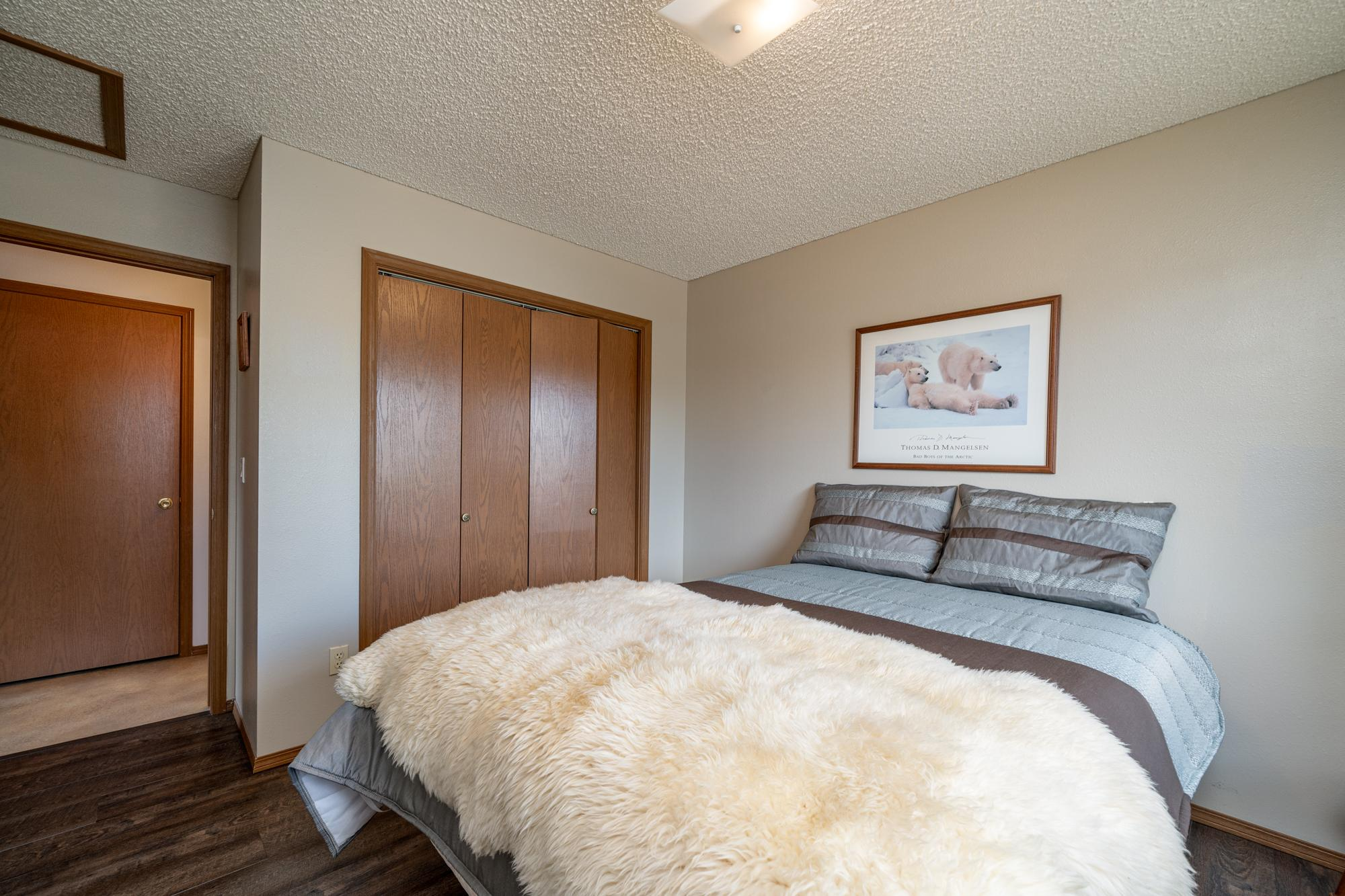 Bedroom with Closet Doors - 1311 Manchester Dr Montrose, CO 81401 - Atha Team Realty Agents