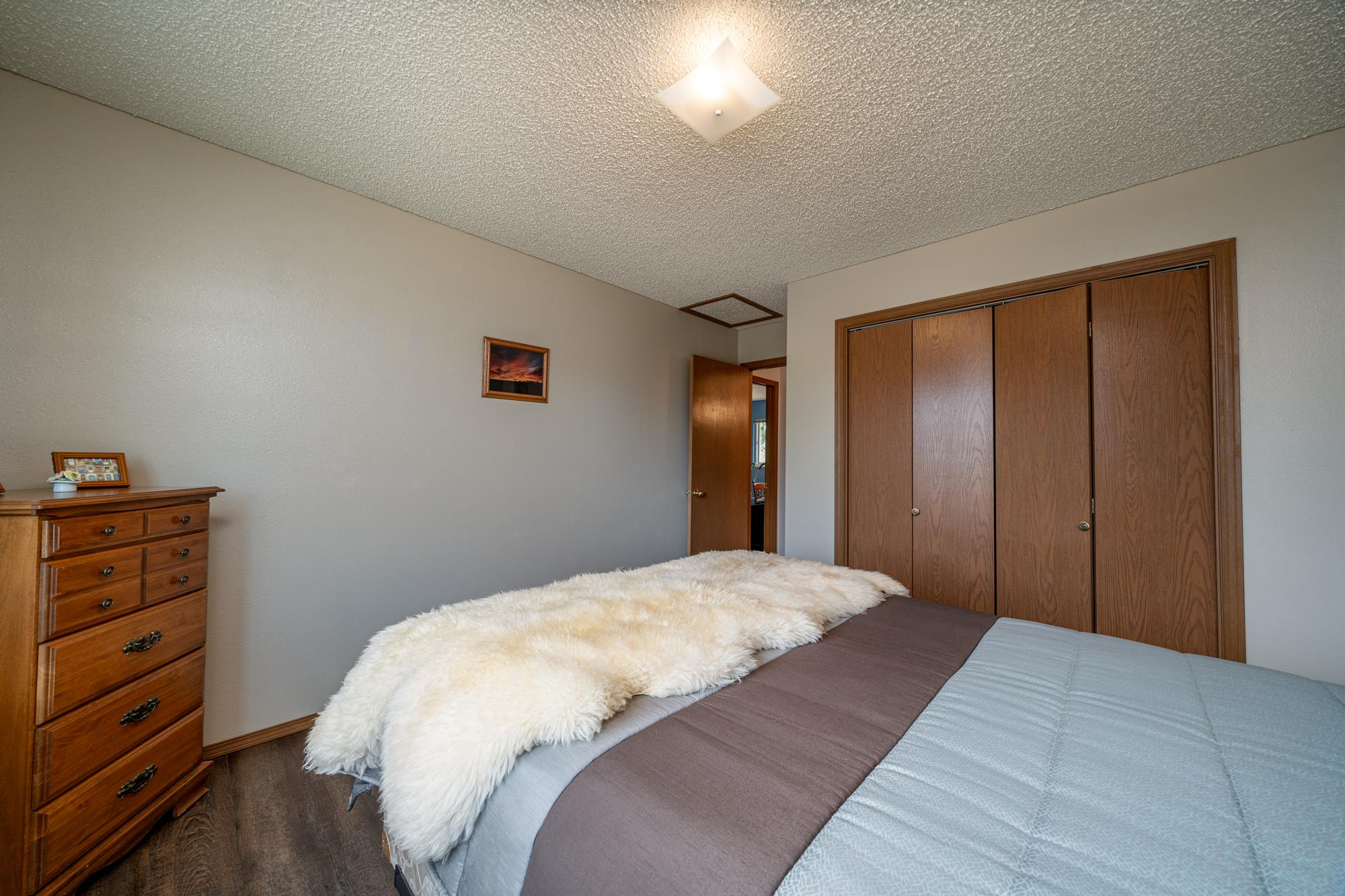 Bedroom with Ceiling Light - 1311 Manchester Dr Montrose, CO 81401 - Atha Team Realty Agents