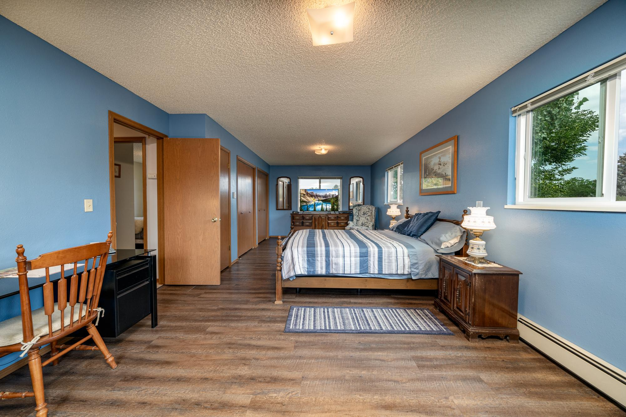 Bedroom with Vinyl Wood Flooring - 1311 Manchester Dr Montrose, CO 81401 - Atha Team Realty Agents