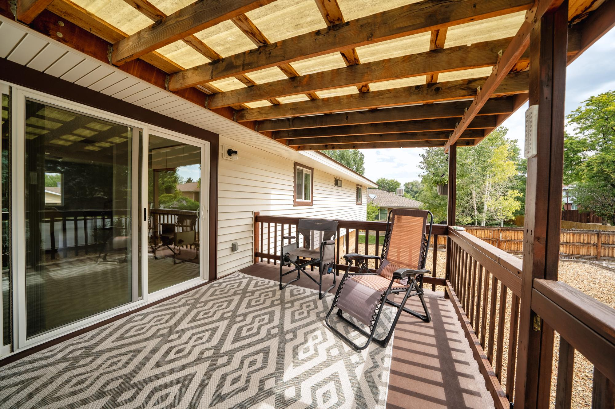 Covered Porch with Sliding Glass Door - 1311 Manchester Dr Montrose, CO 81401 - Atha Team Realty Agents