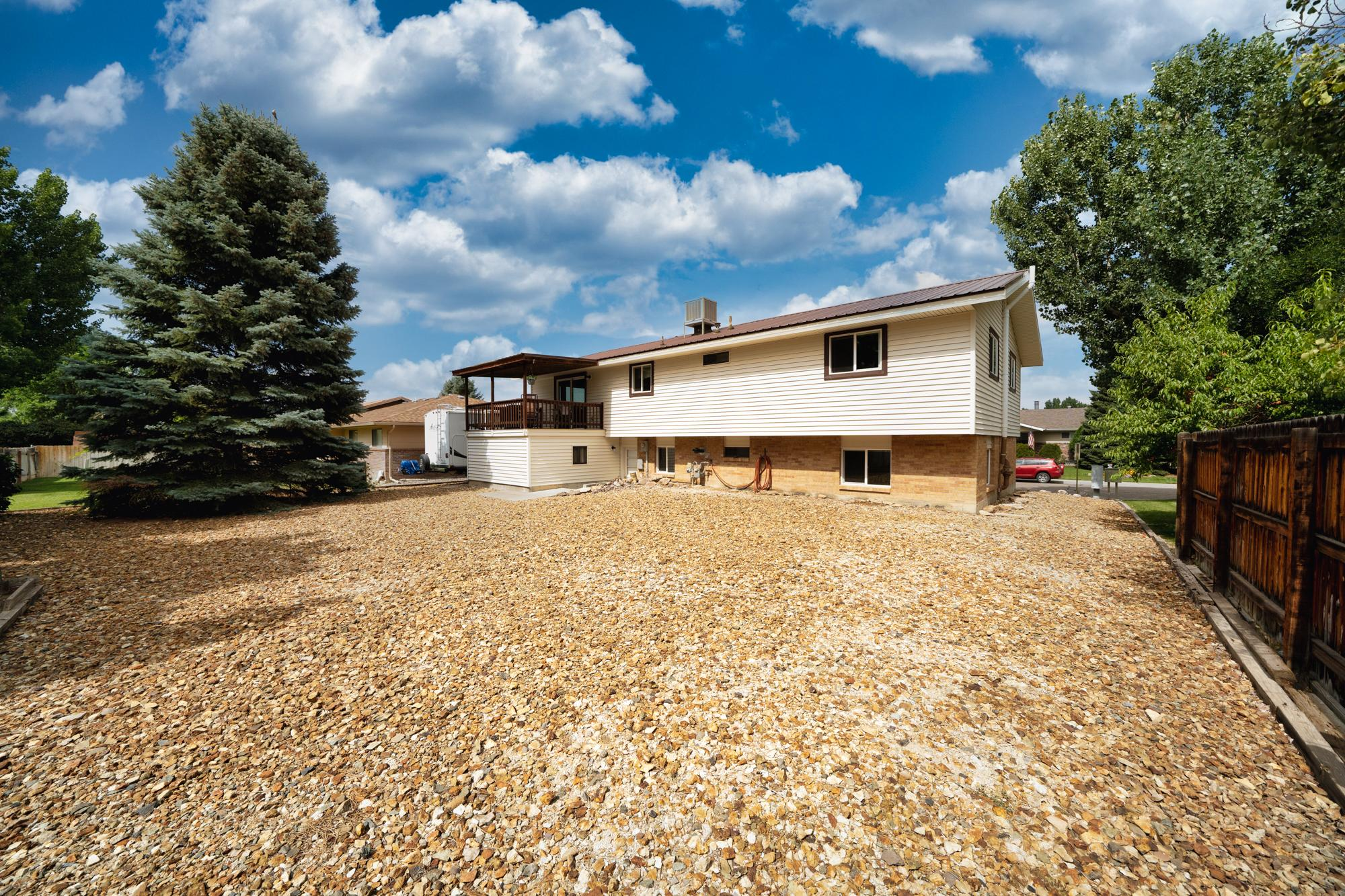 Large Back Yard - 1311 Manchester Dr Montrose, CO 81401 - Atha Team Realty Agents