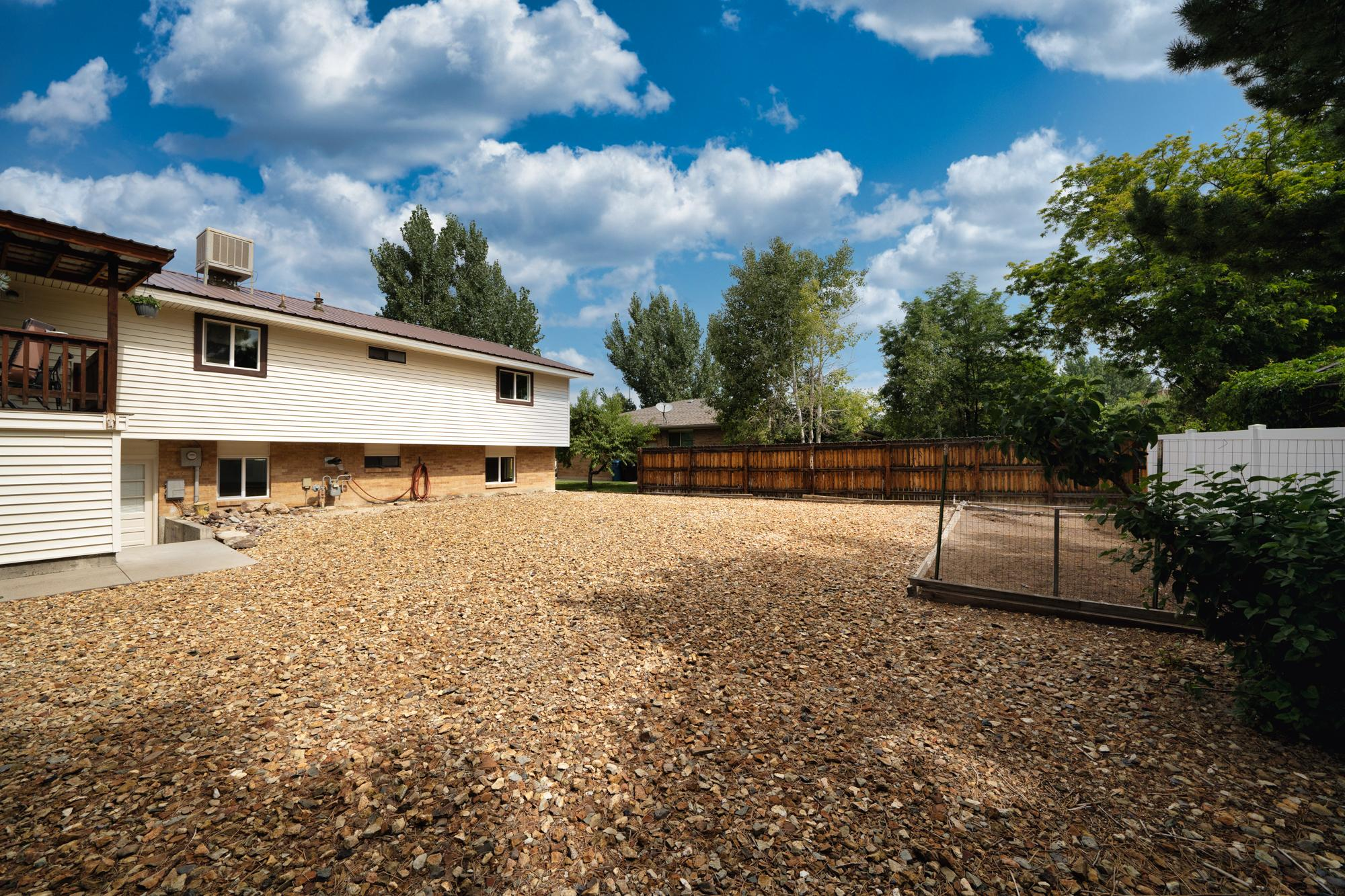 Xeriscaped Back Yard - 1311 Manchester Dr Montrose, CO 81401 - Atha Team Realty Agents