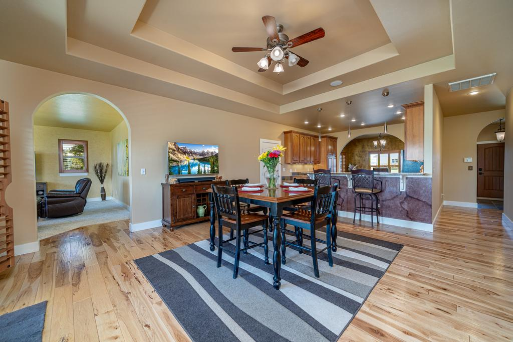 Dining Area with Ceiling Fan - 481 Collins Way Montrose, CO 81403 - Atha Team Cobble Creek Real Estate