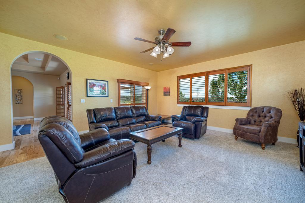 Living Room with Ceiling Fan - 481 Collins Way Montrose, CO 81403 - Atha Team Cobble Creek Real Estate