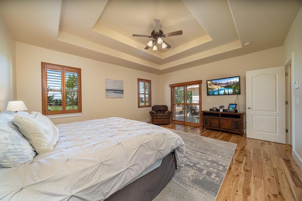 Main Bedroom with Hardwood Flooring - 481 Collins Way Montrose, CO 81403 - Atha Team Cobble Creek Real Estate