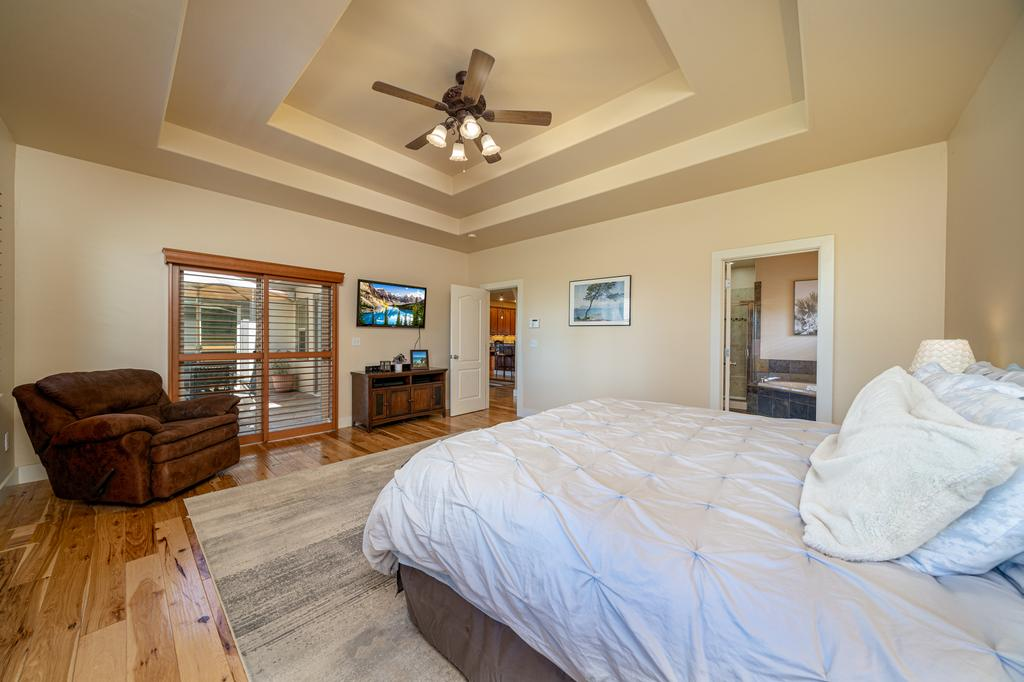 Main Bedroom with Ceiling Fan - 481 Collins Way Montrose, CO 81403 - Atha Team Cobble Creek Real Estate