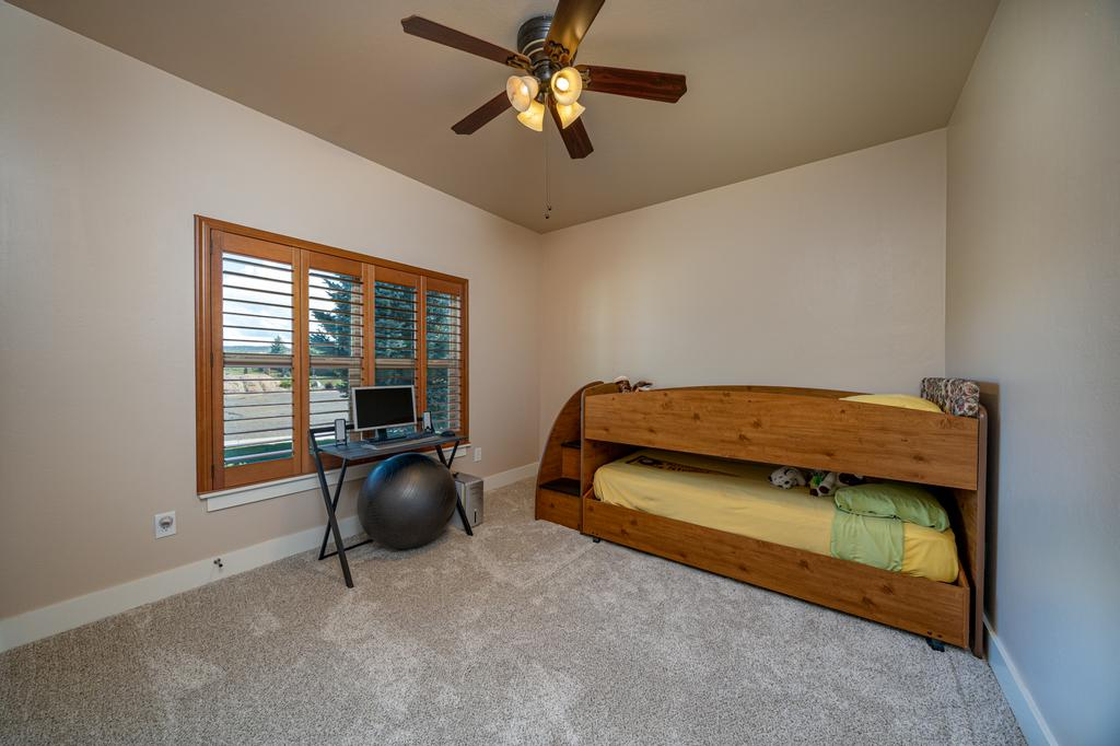 Bedroom with Carpet and Window - 481 Collins Way Montrose, CO 81403 - Atha Team Cobble Creek Real Estate