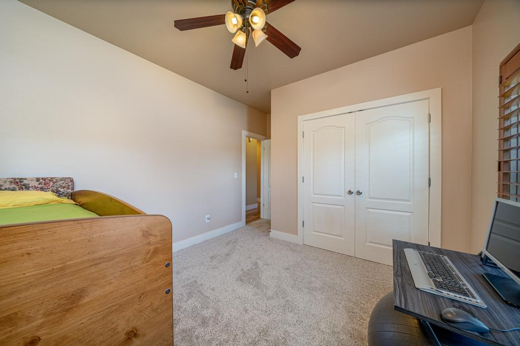 Bedroom with Closet Doors - 481 Collins Way Montrose, CO 81403 - Atha Team Cobble Creek Real Estate