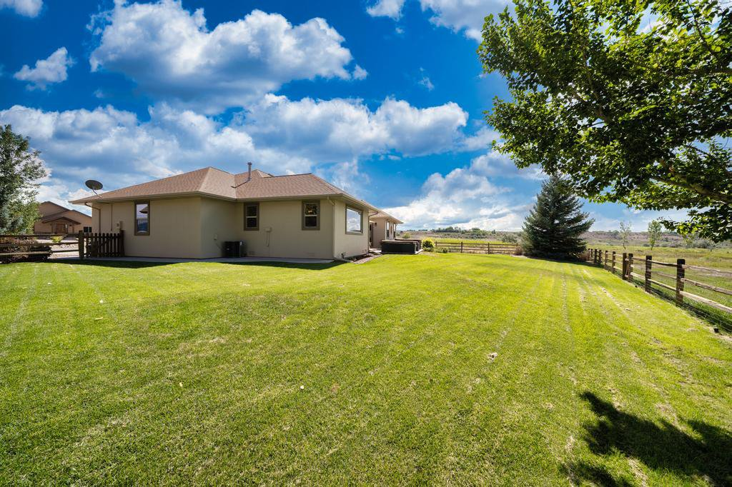 Back Yard View - 481 Collins Way Montrose, CO 81403 - Atha Team Cobble Creek Real Estate