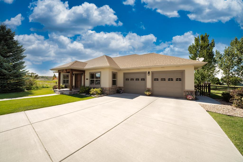 Front of Home with 2 Car Garage - 481 Collins Way Montrose, CO 81403 - Atha Team Cobble Creek Real Estate