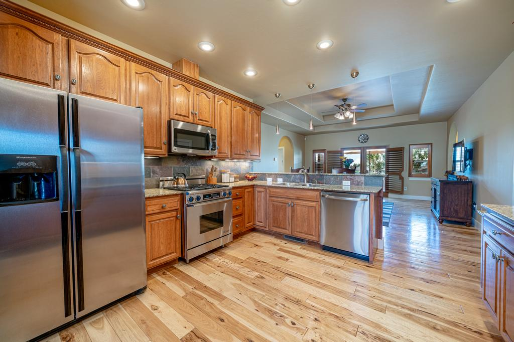 Kitchen with Hardwood Flooring - 481 Collins Way Montrose, CO 81403 - Atha Team Cobble Creek Real Estate