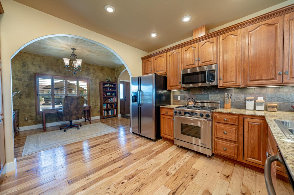 Kitchen with Stainless Steel Appliances - 481 Collins Way Montrose, CO 81403 - Atha Team Cobble Creek Real Estate