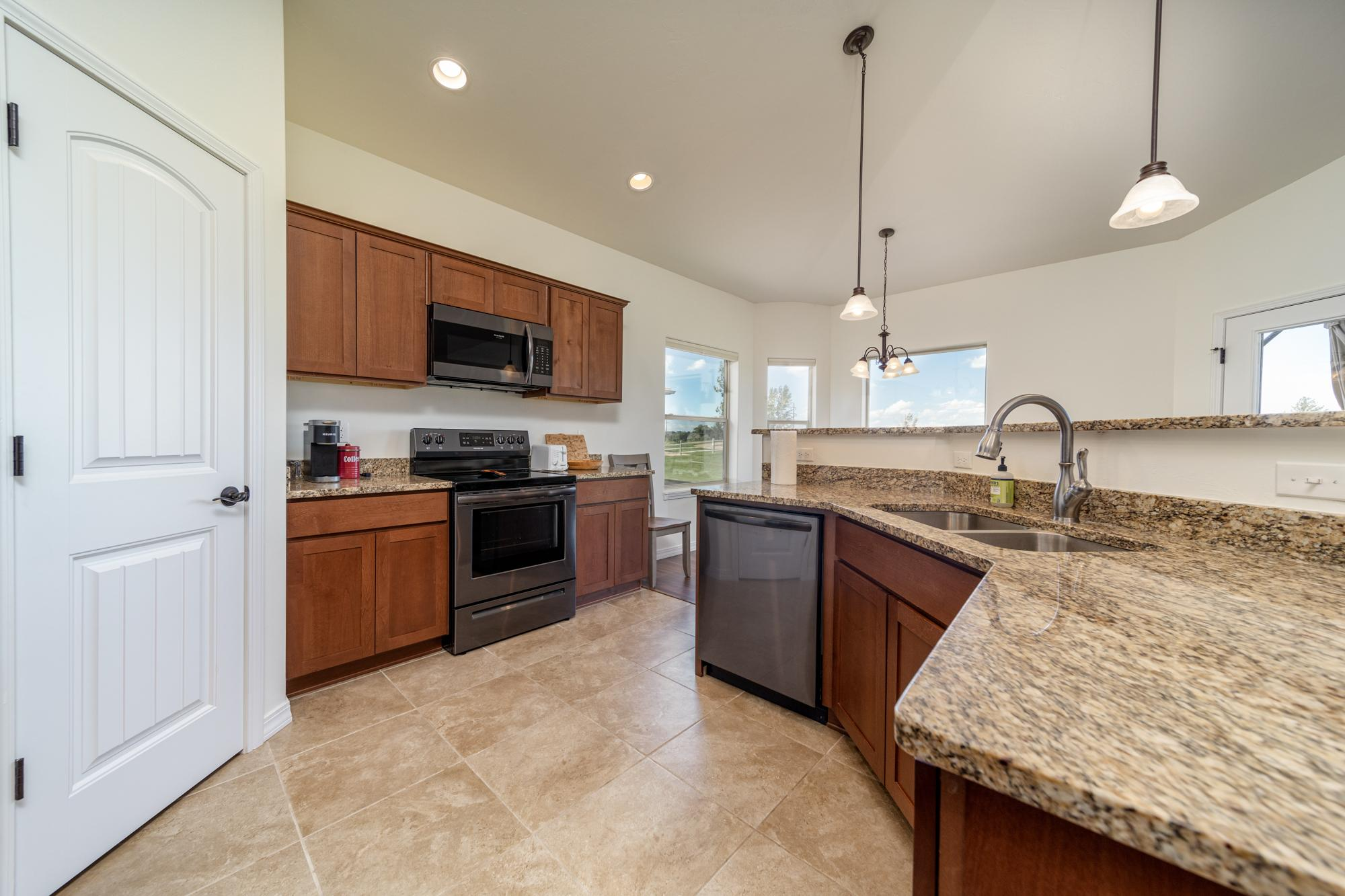 Kitchen with Granite Counters - 597 Cobble Dr Montrose, CO - Atha Team MLS Colorado