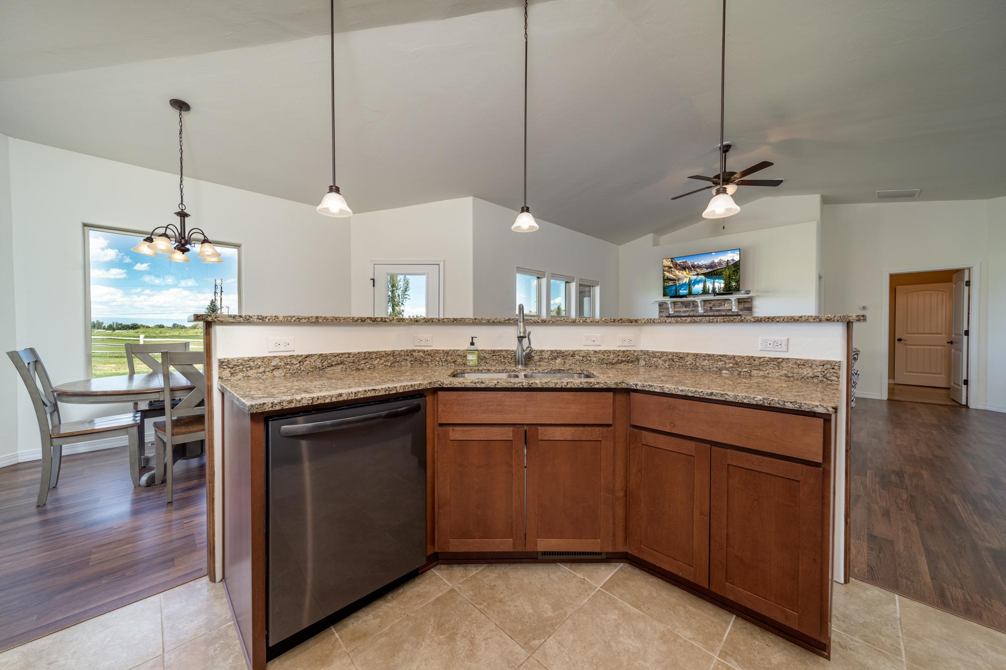 Kitchen with Island Sink - 597 Cobble Dr Montrose, CO - Atha Team MLS Colorado