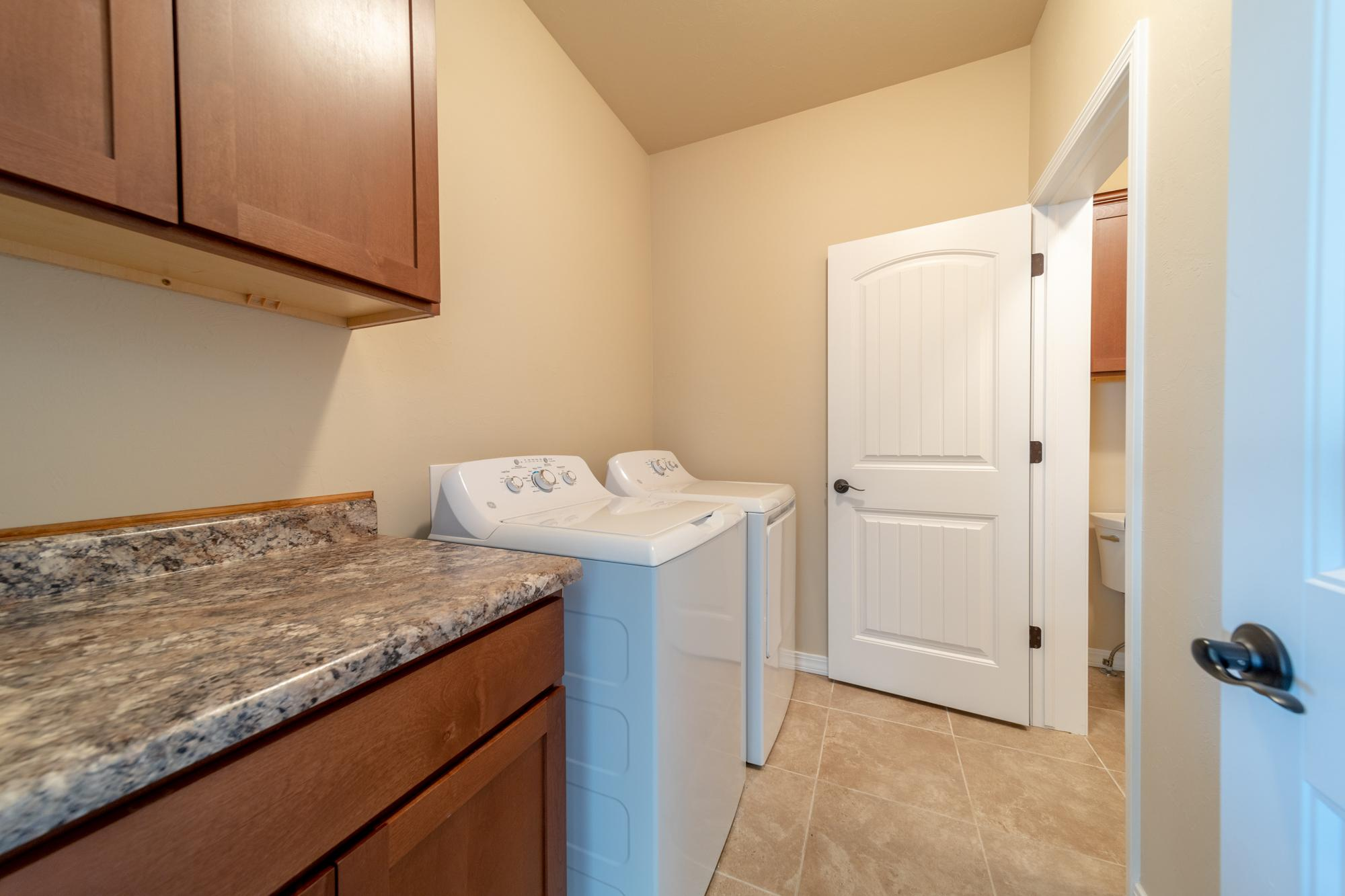 Laundry Room with Counter - 597 Cobble Dr Montrose, CO - Atha Team MLS Colorado