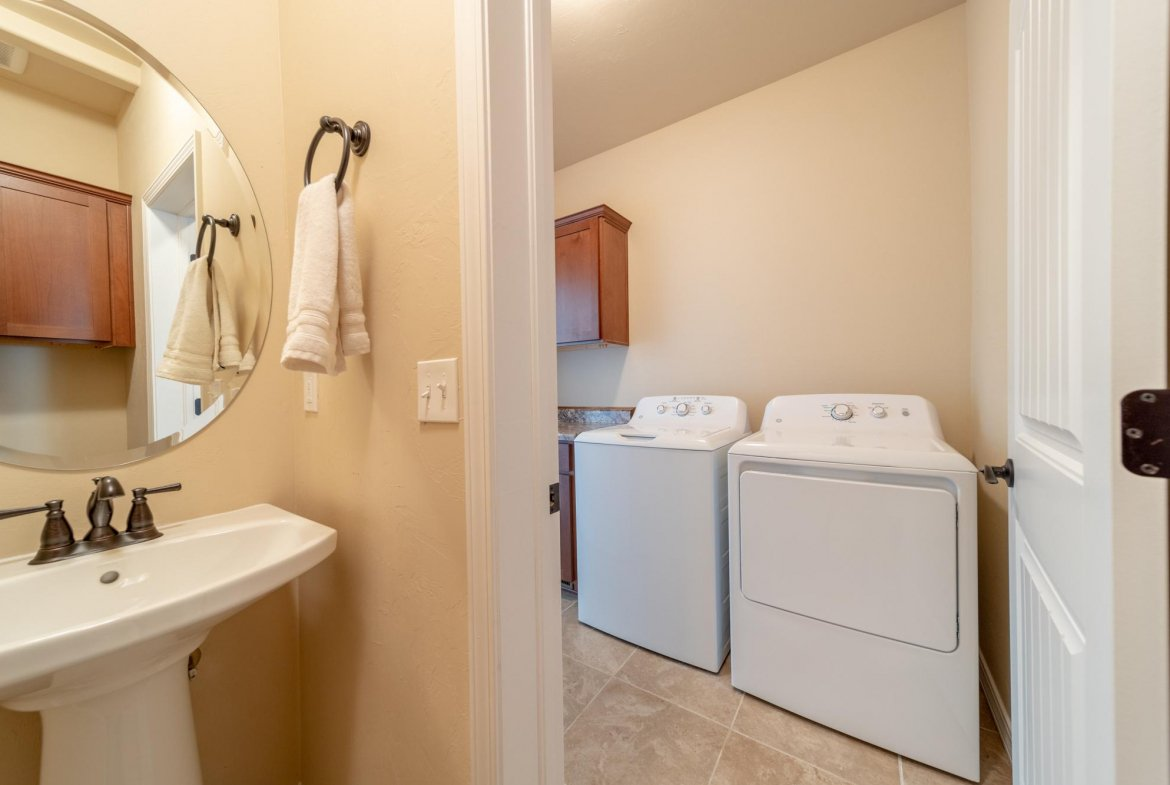 Laundry Room and Bathroom - 597 Cobble Dr Montrose, CO - Atha Team MLS Colorado