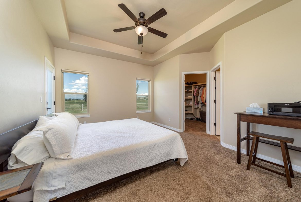 Primary Bedroom with Trey Ceiling - 597 Cobble Dr Montrose, CO - Atha Team MLS Colorado