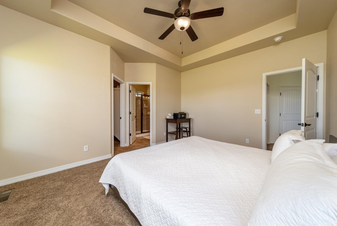 Primary Bedroom with Ceiling Fan - 597 Cobble Dr Montrose, CO - Atha Team MLS Colorado