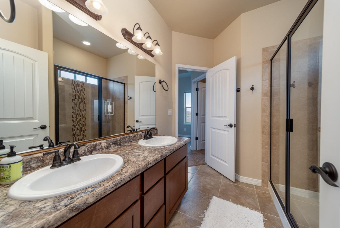 Primary Bathroom with Dual Sinks - 597 Cobble Dr Montrose, CO - Atha Team MLS Colorado