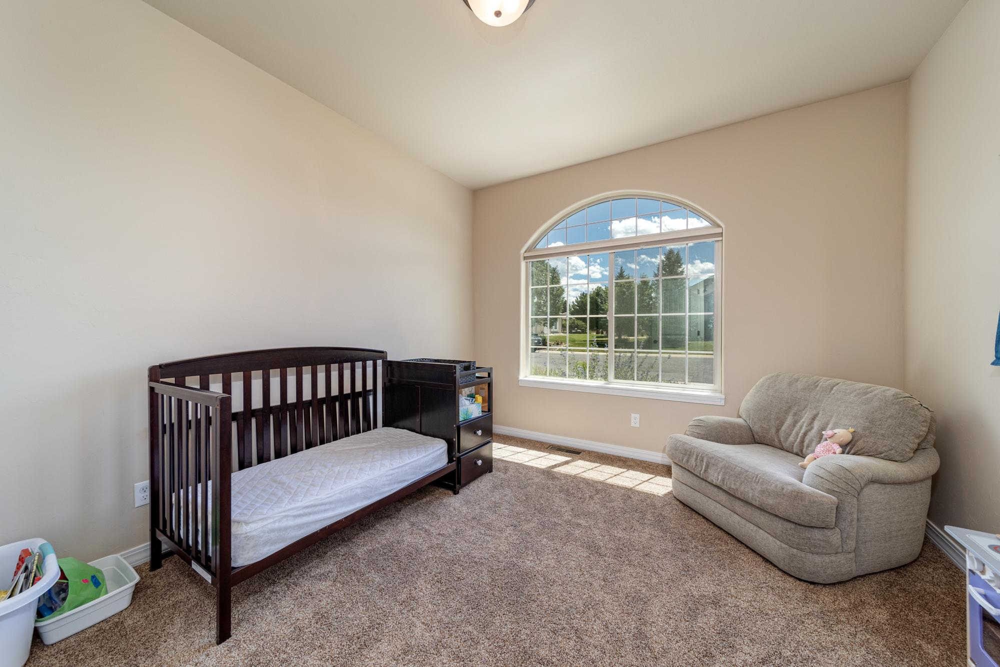 2nd Bedroom with Custom Window - 597 Cobble Dr Montrose, CO - Atha Team MLS Colorado